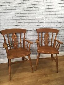 Pair of solid oak fiddle back carver chairs