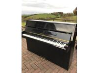 Small modern black Steinback upright piano