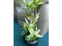 Artificial plant arrangement in bowl