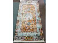 16 colours antique rug
