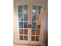 Double 10 panel timber glazed doors painted white