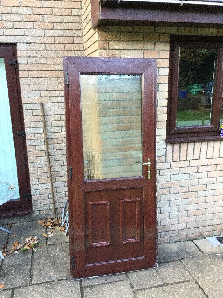 Rosewood Upvc rear door brass handles good condition