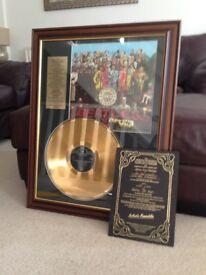 Commemorative Beatles Sgt Pepper gold disc
