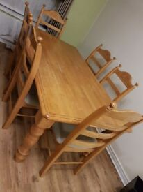 Large solid table & 6 chairs