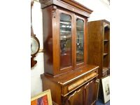 Victorian bookcase glazed doors over two cupboard