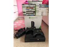 Xbox 360, comes with box, 2 controllers and 25 games.