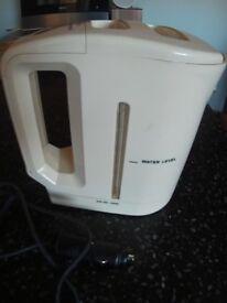 Travel Kettle 12/24 volt. Cigarette lighter plug.