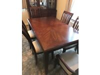 Dining table and 6 chairs up for grabs