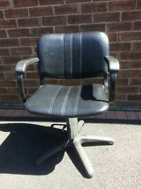 Hairdressers hydraulic chairs