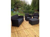 Black Rattan furniture set.