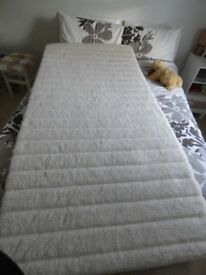 Single bed sized Massage Mattress.Never used..Covered in pure Merino lambs wool
