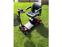 GOGO ELITE TRAVELLER PLUS mobility scooterin red, 23 stone user capacity, good condition