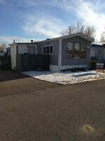 # 31, 6220-17 Avenue SE Three Bed Room mobile home for rent.