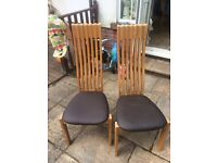 2 oak chairs with leather seat pads