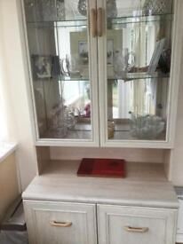 Free standing glass fronted wall unit