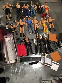 WWE WRESTLING FIGURES AND ACCESSORIES AROUND 15 YEARS OLD
