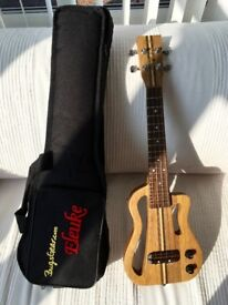"""""""Eleuke"""" solid body electric ukulele. Lovely condition, complete with gig bag."""