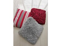 £4 each - mix of Red and grey cushions