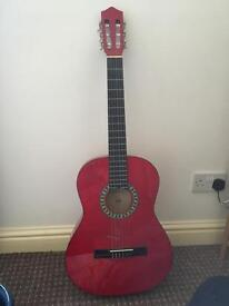 Red Stagg acoustic guitar