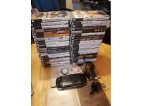 PSP 2003 WITH 37 BOXED GAMES 3 MOVIES,2 UNBOXED UMD'S 64GB MEMORY CARD WITH THOUSANDS OF GAMES