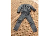 Motor bike leather jacket and trousers.