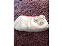 M&S silky cream embossed clutch