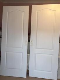 "15 x 30"" used 2 panel white wood grain internal doors"