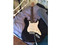Black Squire Strat by Fender Electric Guitar Used with Grey Carry Case