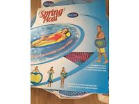 Spring float luxury floating lilo collapses folds into carry bag .
