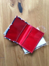 Real leather Union Jack passport holder New and packaged, free luggage label, not many left.