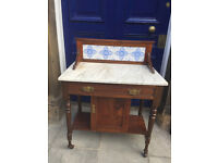 A marble topped ledgeback wash stand .....must be seen. Free local delivery.