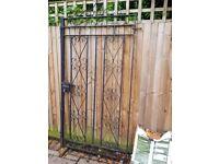 Ornate metal garden gate
