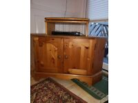 Pine corner cabinets x 2 varnished. I tall I short can be used for tv/video.