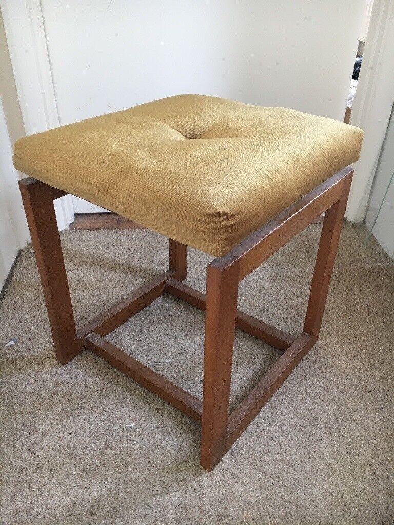 Velvet-topped wooden stool