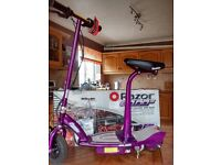 Razor e100s electruc scooter in excellent cindition with box manual, chsrger etc.