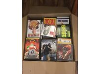 Box of over 100 assorted DVDs and CDs