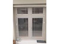 Various white Sunwood blinds