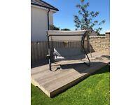 Grey swinging chair