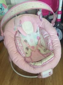 Baby Bouncer Chair. Has vibrate and sound settings to soothe baby. Pink colour.