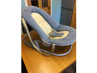 Mamas and Papas baby bouncer in blue and cream.