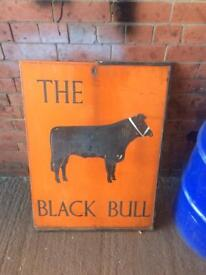 Old metal pub sign