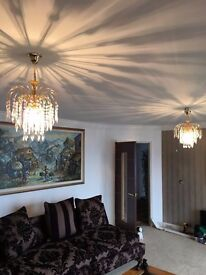Three crystal chandeliers in beautiful gold finish.