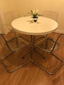 Table & Chairs. Round white table and four transparent IKEA tobias chairs