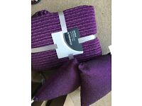 Purple bedspread and cushions