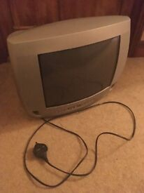 Silver 14 inch Philips TV with remote