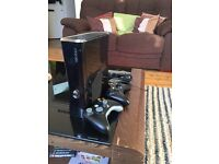 XBOX 360 Slim (Gloss black) with 2 controllers and headset 120gb