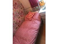 White metal single bed and mattress