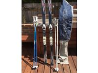 Atomic 3d 185 skis with Soloman 757 bindings, two sets of poles and a ski bag