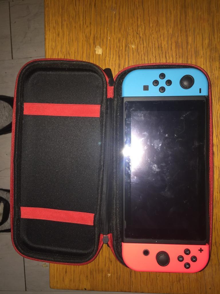 Nintendo switch in box with carry case