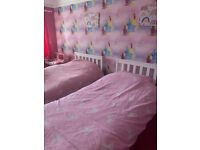 Two children's wooden beds single